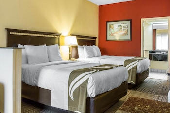 Guestroom at Quality Suites in Orlando