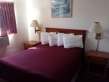 Guestroom at Travelodge by Wyndham San Diego SeaWorld in San Diego