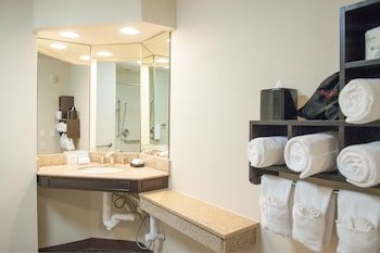 Two queens beds with accessible tub