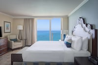 <p><strong>1 King Bed</strong></p><p>750-sq-foot (70-sq-meter) room, balcony with ocean views</p><br/><p><b>Layout</b> - Bedroom, living room, and dining area</p><p><b>Internet</b> - Free WiFi and wired Internet access</p><p><b>Entertainment</b> - 47-inch Smart TV with premium channels and Netflix</p><p><b>Food & Drink</b> - Refrigerator, coffee/tea maker, and room service</p><p><b>Sleep</b> - Premium bedding, blackout drapes/curtains, and turndown service </p><p><b>Bathroom</b> - Private bathroom, shower/tub combination, bathrobes, and free toiletries</p><p><b>Practical</b> - Laptop-compatible safe, double sofa bed, and iron/ironing board; free cribs/infant beds available on request</p><p><b>Comfort</b> - Air conditioning and daily housekeeping</p><p>Non-Smoking</p>&nbsp;