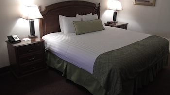Guestroom at Ramada by Wyndham Kissimmee Downtown Hotel in Kissimmee