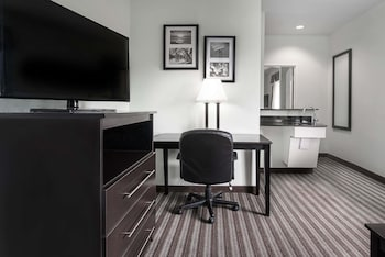 Guestroom at Days Inn & Suites by Wyndham Dallas in Dallas
