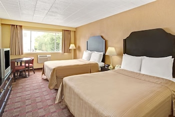 Guestroom at Howard Johnson by Wyndham Pikesville in Pikesville
