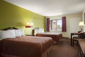 Guestroom at Howard Johnson by Wyndham Grand Prairie Near Lone Star Park in Grand Prairie