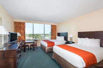 Guestroom at Ramada by Wyndham Kissimmee Gateway in Kissimmee