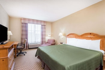 Guestroom at Travelodge by Wyndham Savannah Gateway in Savannah