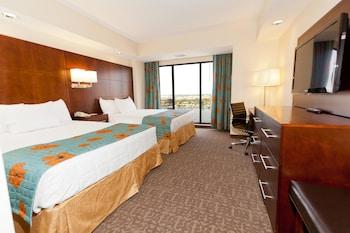 Guestroom at Ramada Plaza Resort & Suites by Wyndham Orlando Intl Drive in Orlando