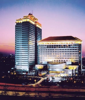Book King Wing Hot Spring International Hotel in Beijing.