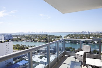Chic Corner Partial Ocean View One Bedroom w/ Den + Balcony