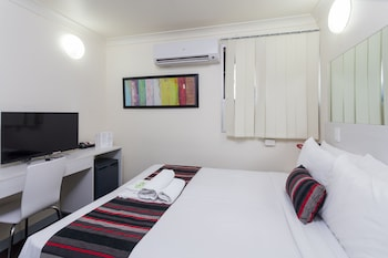 Guestroom at City Edge Brisbane Hotel in Brisbane