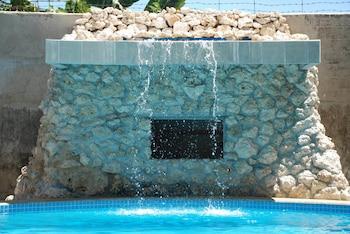 Lapu Lapu Cottages And Restaurant Pool Waterfall