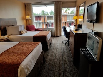 Guestroom at Sun Inn & Suites in Kissimmee
