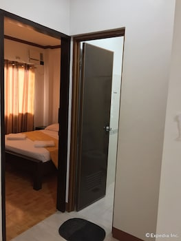 A Family Apartelle Bohol Guestroom