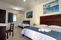 Deluxe Suite, 1 King Bed, Balcony, Pool View