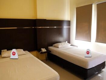 NIDA Rooms Makassar Town Square at Adipura Hotel - Featured Image  - #0