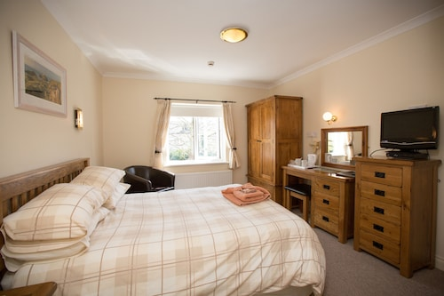 __{offers.Best_flights}__ The Coach House Hotel