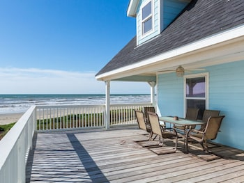 Beachfront Beauty in Galveston by RedAwning