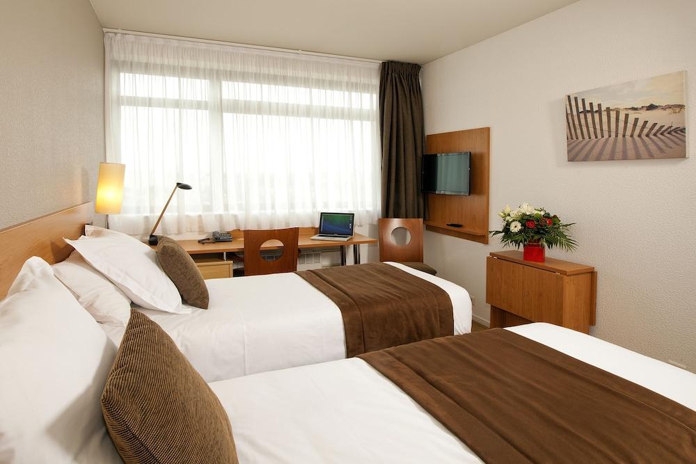 세주르 & 아페레 브레타뉴 - 렌(Séjours & Affaires Bretagne - Rennes) Hotel Image 10 - Guestroom