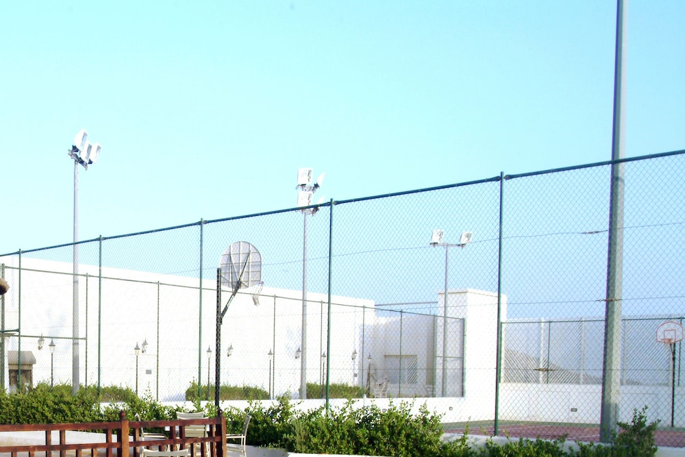 Tennis and Basketball Courts 56 of 155