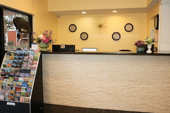 Check-in/Check-out Kiosk at Shining Light Inn & Suites in Kissimmee