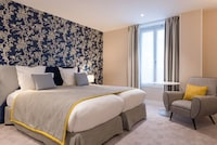 <p><strong>2 Twin Beds</strong></p><p>215-sq-foot (20-sq-meter) room with city views</p><br/><p><b>Relax</b> - In-room massage available</p><p><b>Internet</b> - Free WiFi </p><p><b>Entertainment</b> - 35-inch LCD TV, satellite channels, and iPod dock</p><p><b>Food & Drink</b> - Room service and free bottled water </p><p><b>Sleep</b> - Pillowtop bed, premium bedding, and blackout drapes/curtains </p><p><b>Bathroom</b> - Private bathroom, bathtub or shower, bathrobes, and slippers</p><p><b>Practical</b> - Laptop-compatible safe, desk, and phone</p><p><b>Comfort</b> - Air conditioning and daily housekeeping</p><p><b>Need to Know</b> - No cribs (infant beds) available</p><p>Smoking/Non Smoking</p><p>Connecting/adjoining rooms can be requested, subject to availability </p>&nbsp;