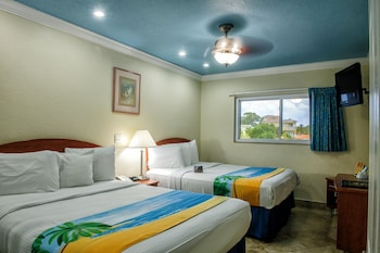 Deluxe One Bedroom Suite: 2 Queen Beds and 2 Sleeper Sofas