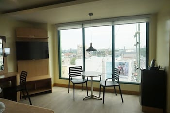 NEW DAWN HOTEL PLUS Living Area
