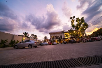 CML BEACH RESORT & WATER PARK Front of Property - Evening/Night
