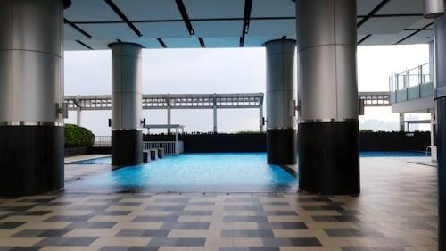 . Big Studio at Cosmo Terrace Apartment Thamrin City By Travelio