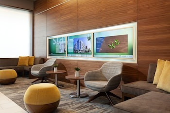 Lobby Sitting Area at SpringHill Suites by Marriott Orlando at Millenia in Orlando