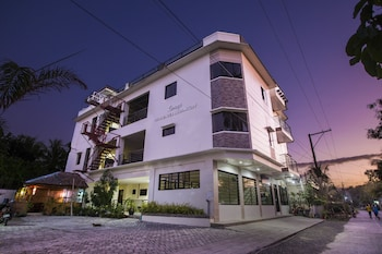SPACIOUS PRIVATE APARTMENT AT LAORENZA RESIDENCES Front of Property - Evening/Night