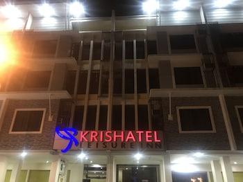 KRISHATEL LEISURE INN Front of Property - Evening/Night