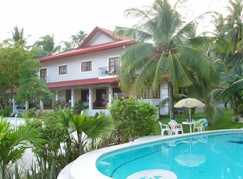 Las Flores Country & Beachside Hotel Cebu Featured Image