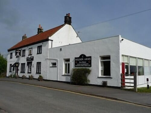 . The Wilson Arms