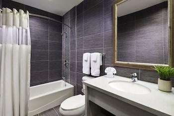 Bathroom at American Inn in Downey
