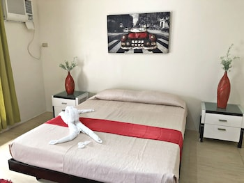 QUEZON PREMIER HOTEL CANDELARIA Room