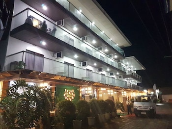 THE PREMIERE BUSINESS HOTEL Front of Property - Evening/Night