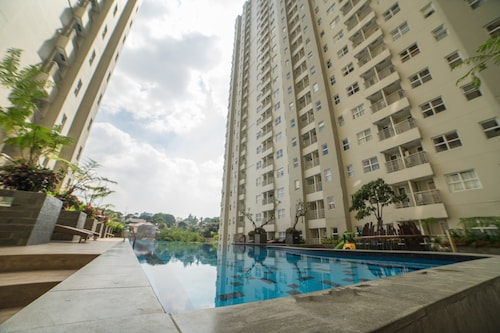 Cozy Apartment at Parahyangan Residence with Direct Access to Swimming, Bandung