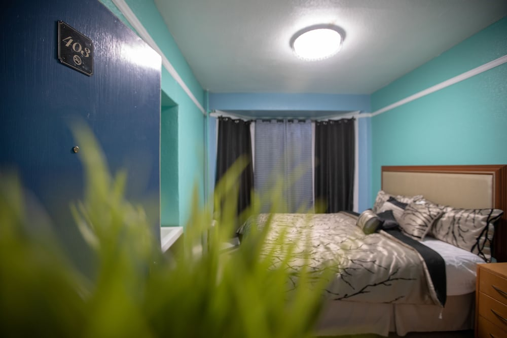 Basic Single Room, 1 full Bed, Non Smoking (Shared Bathroom)