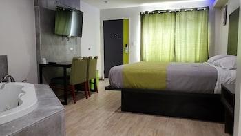 尊爵套房旅館 Exclusivo Inn & Suites