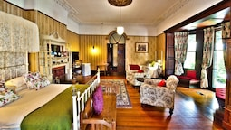 Large Family Suite Multiple Beds Fireplace Verandah And Private Bathroom Across The Hall