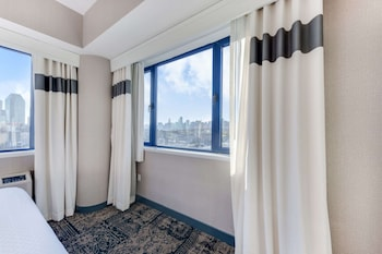 Executive Suite, 1 King Bed, Refrigerator & Microwave, City View (Walk-in Shower;with Sofabed)
