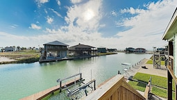 Canal-front Getaway W/ Enclosed Deck & Boat Dock 4 Bedroom Home