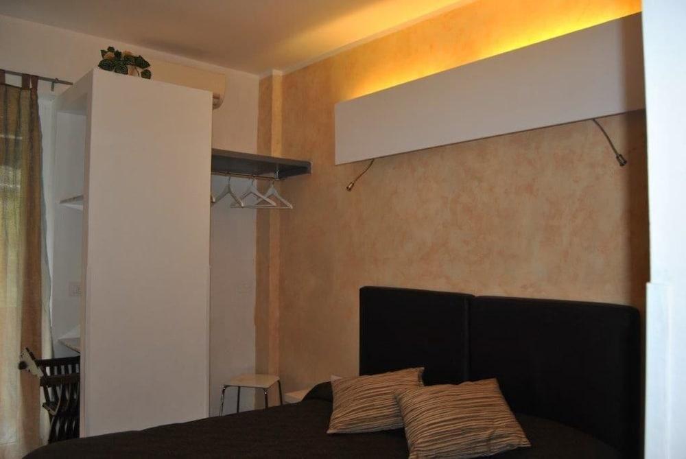호텔 세레노(Hotel Sereno) Hotel Image 17 - Guestroom