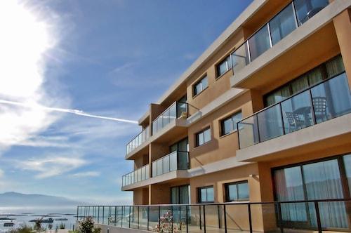. Apartamentos Turísticos Playa de Osmo