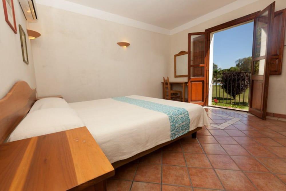 레지던스 바이아 델레 팔메(Residence Baia delle Palme) Hotel Image 14 - Guestroom