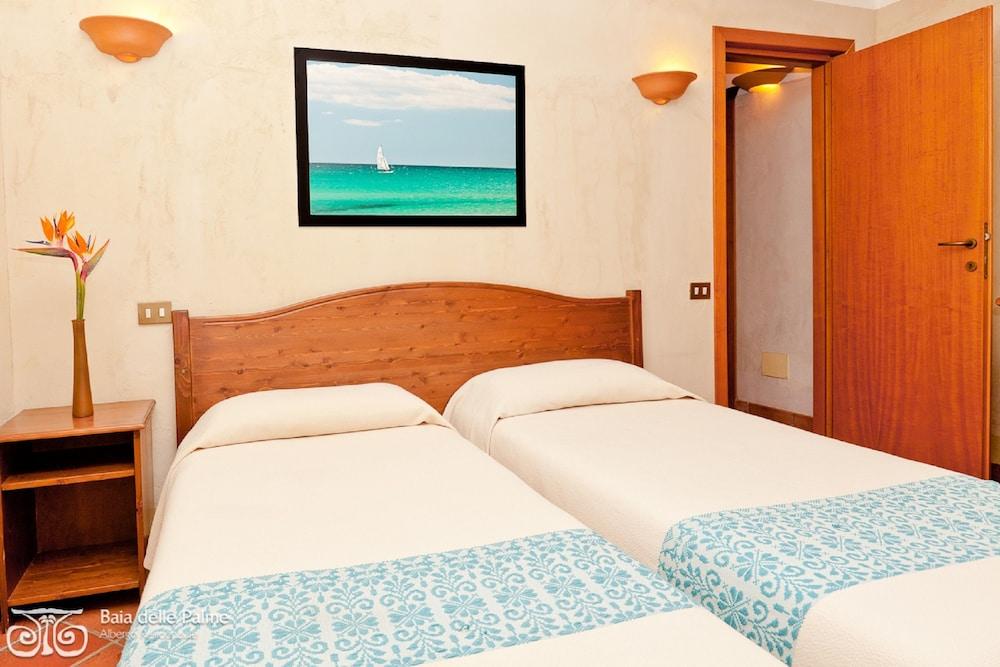 레지던스 바이아 델레 팔메(Residence Baia delle Palme) Hotel Image 7 - Guestroom
