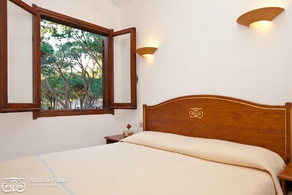 레지던스 바이아 델레 팔메(Residence Baia delle Palme) Hotel Image 9 - Guestroom