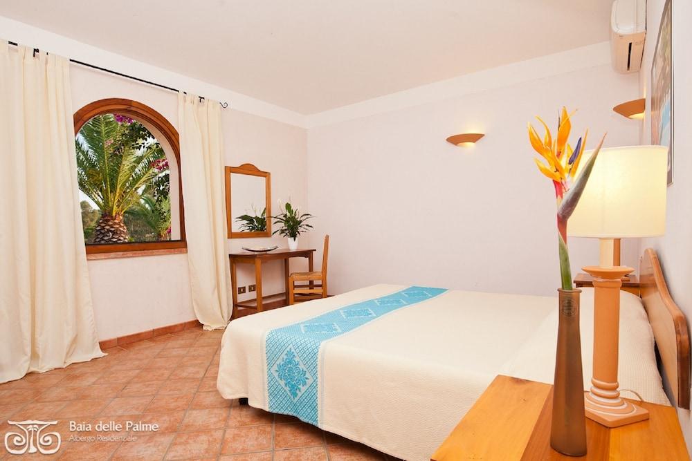 레지던스 바이아 델레 팔메(Residence Baia delle Palme) Hotel Image 12 - Guestroom