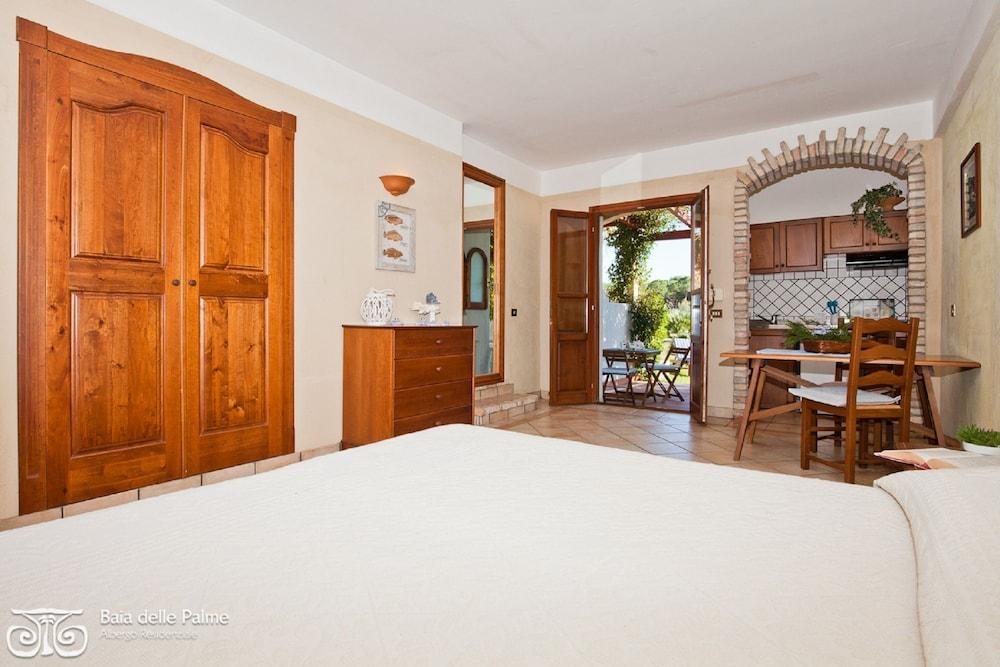 레지던스 바이아 델레 팔메(Residence Baia delle Palme) Hotel Image 4 - Guestroom
